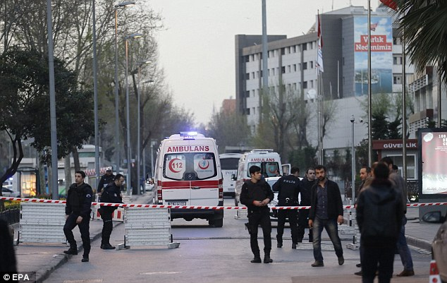 Turkish police secure the area in front of the Istanbul police headquarters where an armed woman was shot dead