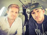 """Nico Rosberg and Lewis Hamilton 02/04/2015 """"Good team factory visit today. Coming up with a plan to beat the red cars in shanghai!""""  from Nico Rosberg Twitter"""