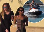 Exclusive. Coleman-Rayner. \nMiami, FL. USA. 2nd April, 2015.\nKhloe Kardashian watches as on-off boyfriend French Montana jet-skis around Miami during a Spring Break vacation. Khloe and French were then pictured sitting together on the dock while French smoked and took a couple more sips before walking back to P. Diddy's house where they are staying with friends.\nCREDIT LINE MUST READ: Coleman-Rayner\nTel US (001) 323 687 8025 - Mobile\nTel US (001) 310 474 4343 - Office\nwww.coleman-rayner.com