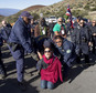Department of Land and Natural Resources officers arrest a Thirty Meter Telescope protester at the telescope building site on the summit of Mauna Kea in Hilo, Hawaii, Thursday, April 2, 2015. Protesters are preventing construction of a giant telescope near the summit of a mountain held sacred by Native Hawaiians. Some consider the $1.4 billion Thirty Meter Telescope project as desecrating the Big Island's Mauna Kea. Astronomers say the telescope will allow them to see some 13 billion light years away. (AP Photo/Hawaii Tribune-Herald, Hollyn Johnson)