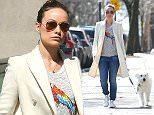 Olivia Wilde was seen cleaning up after her dog Paco as she took him for a walk around her Brooklyn neighborhood this morning. She was also seen getting coffee before heading back to her home.  Pictured: Olivia Wilde Ref: SPL989857  020415   Picture by: Splash News  Splash News and Pictures Los Angeles: 310-821-2666 New York: 212-619-2666 London: 870-934-2666 photodesk@splashnews.com