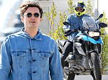135034, EXCLUSIVE: Orlando Bloom seen zipping off on his 2013 BMW R1200GS motorcycle after breakfast and a stroll on the Malibu pier with a friend. The actor sported a blue denim jacket, black jeans, sunglasses, and a neon yellow helmet. Malibu, California - Thursday April 02, 2015. Photograph: Pedro Andrade, © PacificCoastNews. Los Angeles Office: +1 310.822.0419 sales@pacificcoastnews.com FEE MUST BE AGREED PRIOR TO USAGE