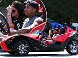 **USA ONLY** *EXCLUSIVE* Woodland Hills, CA - Kylie Jenner tries to cover her face while joy riding with rumored boyfriend Tyga in his Slingshot 3 wheel Motorcycle.  All though the two fail to speak and reveal too much about their relationship, they both look very comfortable with each other to label them as a couple.  The Slingshot Motorcycle is a fast machine and both Tyga and Kylie decided to ride without helmets.  What would momager Kris Jenner say?\\n\\nAKM-GSI        April 2, 2015\\n\\n**MANDATORY CREDIT MUST READ: FameFlynet/AKM-GSI**\\n\\nTo License These Photos, Please Contact :\\n \\n Steve Ginsburg\\n (310) 505-8447\\n (323) 423-9397\\n steve@akmgsi.com\\n sales@akmgsi.com\\n \\n or\\n \\n Maria Buda\\n (917) 242-1505\\n mbuda@akmgsi.com\\n ginsburgspalyinc@gmail.com