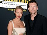 """FILE - March 27: Actor Sam Worthington and Lara Bingle welcome their first child, a baby boy. LOS ANGELES, CA - MARCH 19:  Lara Bingle and actor Sam Worthington attend the premiere of Open Road Films' """"Sabotage"""" at Regal Cinemas L.A. Live on March 19, 2014 in Los Angeles, California.  (Photo by Jason Kempin/Getty Images)"""