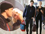 """Josh Hartnett & his girlfriend, English model, Tamsin Egerton spotted catching a flight out of Los Angeles.  The adorable couple were seen at LAX as the """"Pearl Harbor"""" star lovingly caressed his girlfriend who was showing off her amazing legs.\n\nPictured: Josh Hartnett,Tamsin Egerton\nRef: SPL991125  030415  \nPicture by: Splash News\n\nSplash News and Pictures\nLos Angeles: 310-821-2666\nNew York: 212-619-2666\nLondon: 870-934-2666\nphotodesk@splashnews.com\n"""