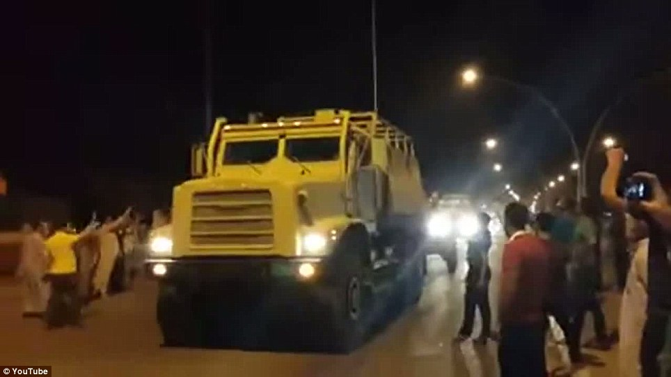 Armed and dangerous: This video reportedly shows dozens of vehicles including several Police SUVs, large military trucks and at least two artillery weapons