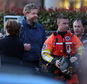 Louis Jordan, second from left, walks from the Coast Guard helicopter to the Sentara Norfolk General Hospital in Norfolk, Va., after being found off the North Carolina coast, Thursday, April 2, 2015. His family says he sailed out of a marina in Conway, S.C., on Jan. 23, and hadn't been heard from since. (AP Photo/The Virginian-Pilot, Steve Earley)