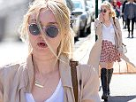 UK CLIENTS MUST CREDIT: AKM-GSI ONLY EXCLUSIVE: Dakota Fanning looking trendy with sunglasses and boots walking around Soho in New York City.  Pictured: Dakota Fanning Ref: SPL990588  020415   EXCLUSIVE Picture by: AKM-GSI / Splash News