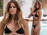 Kelly Bensimon relaxes in the pool at the Delano Hotel in South Beach while on vacation for the Easter Holiday with her daughters. The reality star showed of her tanned and toned bikini body wearing a Melissa Odabash black string bikini.\n\nPictured: Kelly Bensimon\nRef: SPL988774  020415  \nPicture by: Ralph Notaro / Splash News\n\nSplash News and Pictures\nLos Angeles: 310-821-2666\nNew York: 212-619-2666\nLondon: 870-934-2666\nphotodesk@splashnews.com\n