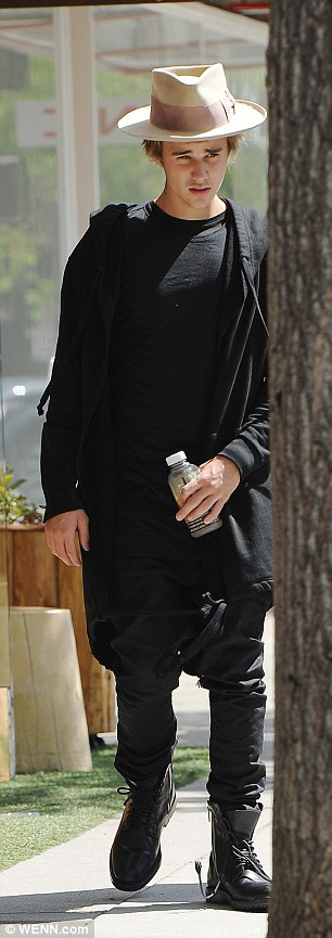 All-black everything: The Baby hitmaker layered up in an all-black look despite the blazing sunshine