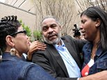 Death row inmate Anthony Ray Hinton is greeted by family outside the Jefferson County Jail in Birmingham, Alabama April 3, 2015. Hinton, 59, walked out of the jail a free man on Friday morning after almost 30 years on death row in Alabama for a crime he did not commit. REUTERS/Marvin Gentry