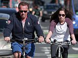 135079, EXCLUSIVE: The family that rides together stays together. Arnold Schwarzenegger and his daughter Christina take a morning bike ride before heading to the gym to work out. Los Angeles, California - Friday April 3, 2015. Photograph: KVS/Pedro Andrade, © PacificCoastNews. Los Angeles Office: +1 310.822.0419 sales@pacificcoastnews.com FEE MUST BE AGREED PRIOR TO USAGE