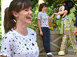 Jennifer Garner poses with Mickey Mouse at Disneyland and also rides the Dumbo Ride in Fantasyland. Jennifer was there spending quality times with her friends and family and took some time out to take a quick picture with the popular mouse  Pictured: Jennifer Garner Ref: SPL989413  030415   Picture by: Fern / Splash News  Splash News and Pictures Los Angeles: 310-821-2666 New York: 212-619-2666 London: 870-934-2666 photodesk@splashnews.com