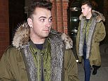 EXCLUSIVE TO INF. April 2, 2015: Sam Smith is spotted all bundled up at St Pancras Train Station in London, UK after arriving in to London by the Eurostar train. Mandatory Credit:  Paige/INFphoto.com Ref.:infuklo-166