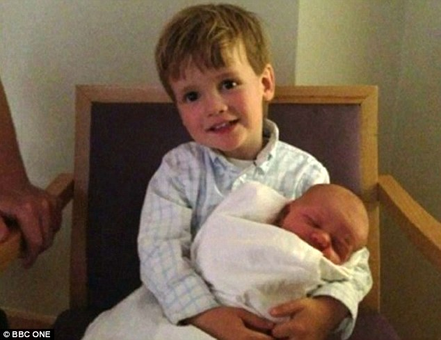 Happy family: Chris and Natasha are parents to four-year-old son Noah and Eli, now one, seen here in a picture shortly after his birth
