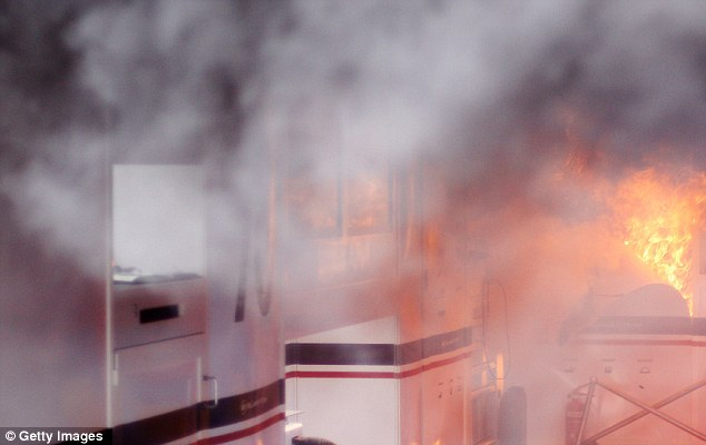 On fire: The incident is believed to have been caused by a Kers unit from Bruno Senna's car
