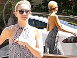 Please contact X17 before any use of these exclusive photos - x17@x17agency.com   PREMIUM EXCLUSIVE - Kate Hudson was spotted in a delightful summer dress,  her hair pulled back into a braid, with sunglasses, preparing for the upcoming Coachella music festival.  Friday, April 3, 2015 X17online.com