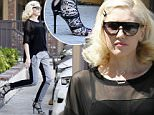 """Los Angeles, CA - """"No Doubt"""" singer Gwen Stefani heads to her weekly acupuncture sessions in Koreatown. The leggy beauty had her short bob styled in curls and wore a sheer black top and two-toned trousers.  \nAKM-GSI        April 3, 2015\nTo License These Photos, Please Contact :\nSteve Ginsburg\n(310) 505-8447\n(323) 423-9397\nsteve@akmgsi.com\nsales@akmgsi.com\nor\nMaria Buda\n(917) 242-1505\nmbuda@akmgsi.com\nginsburgspalyinc@gmail.com"""
