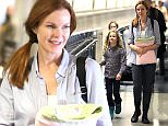 """Marcia Cross & her adorable family are spotted arriving into Los Angeles.  The adorable """"Desperate Housewives"""" actress was seen at LAX waiting for their ride.  Marcia Cross carried a personalized bag for her daughter, Eden.  Pictured: Marcia Cross, Tom Mahoney, Eden Mahoney, Savannah Mahoney Ref: SPL991710  030415   Picture by: Splash News  Splash News and Pictures Los Angeles: 310-821-2666 New York: 212-619-2666 London: 870-934-2666 photodesk@splashnews.com"""