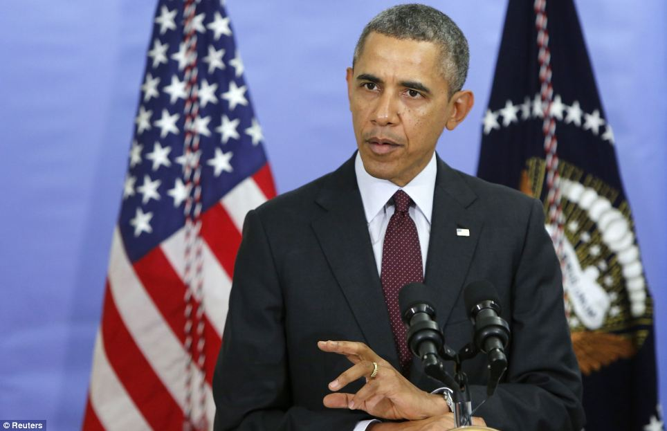 U.S. President Barack Obama answers a question after it was announced the country would deliver $1billion in aid to Ukraine