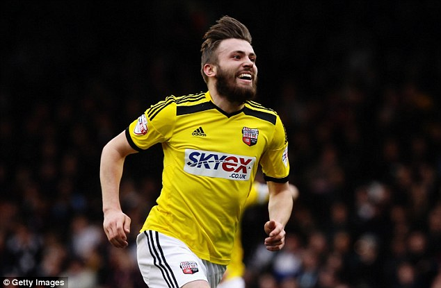 Stuart Dallas celebrates the second of his two excellent goals against Fulham on good Friday