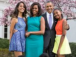 President Barack Obama, First Lady Michelle Obama, and daughters Malia and Sasha pose for a family portrait with Bo and Sunny in the Rose Garden of the White House on Easter Sunday, April 5, 2015.\n(Official White House Photo by Pete Souza)