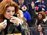 NEW YORK, NY - APRIL 04:  Daniel Zelman, Roman Zelman and Debra Messing attend New Jersey Devils vs New York Rangers game at Madison Square Garden on April 4, 2015 in New York City.  (Photo by James Devaney/GC Images)