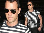 Los Angeles, CA - Handsome Justin Theroux touches down at LAX in a striped shirt, black denim jeans, and brown suede shoes.  \nAKM-GSI        April 4, 2015\nTo License These Photos, Please Contact :\nSteve Ginsburg\n(310) 505-8447\n(323) 423-9397\nsteve@akmgsi.com\nsales@akmgsi.com\nor\nMaria Buda\n(917) 242-1505\nmbuda@akmgsi.com\nginsburgspalyinc@gmail.com