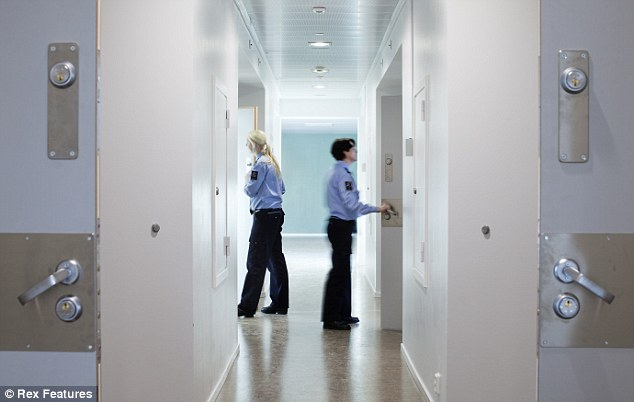 A jail cell corridor in the new prison - where half the guards are female as it is believed this decreases aggression