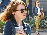 UK CLIENTS MUST CREDIT: AKM-GSI ONLY EXCLUSIVE: Actress, Emma Stone, wore a pair of yellow geometric print pants to go shopping at the Malibu Lumber Yard. She paired her spring-ready pants with a white tee and denim jacket.  Pictured: Emma Stone Ref: SPL991595  030415   EXCLUSIVE Picture by: AKM-GSI / Splash News