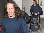 04.APRIL.2015 - LOS ANGELES - USA  *** EXCLUSIVE ALL ROUND PICTURES AVAILABLE FOR UK ONLY *** AMERICAN ACTOR CHRISTIAN BALE APPEARED IN A SURPRISINGLY CHIPPER MOOD AS HE ARRIVED AT LOS ANGELES INTERNATIONAL AIRPORT IN CALIFORNIA. THE BATMAN STAR PUSHED AN EMPTY STROLLER AND STOPPED TO POSE FOR PHOTOS WITH FANS. BYLINE MUST READ : XPOSUREPHOTOS.COM ***UK CLIENTS - PICTURES CONTAINING CHILDREN PLEASE PIXELATE FACE PRIOR TO PUBLICATION *** *UK CLIENTS MUST CALL PRIOR TO TV OR ONLINE USAGE PLEASE TELEPHONE 0208 344 2007*