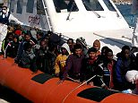 """In this handout videograb released by the Italian coast guards (Guardia Costiera) migrants arrive  in the port of Lampedusa on a boat of the Guardia Costiera following a rescue operation off the coast of Sicily, on April 5, 2015. Some 1,500 migrants trying to cross the Mediterranean to Italy in five different boats were rescued in one day, Italian coastguards said today. Four coastguard vessels and an Italian navy ship intervened Saturday to save three large boats carrying migrants off the Libyan coast after intercepting distress calls from satellite telephones, only to find two other migrants boats in difficulty nearby. RESTRICTED TO EDITORIAL USE - MANDATORY CREDIT """"AFP PHOTO / GUARDIA COSTIERA"""" - NO MARKETING NO ADVERTISING CAMPAIGNS - DISTRIBUTED AS A SERVICE TO CLIENTS-/AFP/Getty Images"""