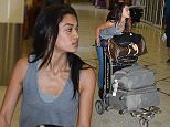 EXCLUSIVE: Australian Victoria's Secret model, Shanina Shaik arrives in Sydney this morning (Sunday 5) just in time to spend Easter Sunday and Monday with family as she made her way through to domestic transfers to board another jet to Melbourne. Her plane was 3 hours delayed. She's due to appear at Australian Fashion Week next week.....Pictured: Shanina Shaik..Ref: SPL984719  040415   EXCLUSIVE..Picture by: Jayden Seyfarth / Splash News....Splash News and Pictures..Los Angeles: 310-821-2666..New York: 212-619-2666..London: 870-934-2666..photodesk@splashnews.com..