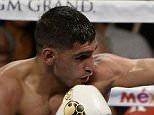 (in white trunks) Amir Khan got 12 rounds with Devon Alexander at the MGM grand hotel Saturday night.  Amir Khan took the win by unanimous decision for the WBC Silver Welterweight Title.