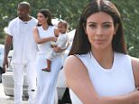 West Hills, CA - Kim Kardashian and Kanye West donned matching white outfits for Easter Sunday as they headed into church for the morning service. The reality star looked beautiful in a flowing white peplum dress as she balanced North on one hip. Kanye translated his usual grunge look to an Easter-appropriate ensemble by simply wearing a ripped white t-shirt and jeans.\nAKM-GSI        April 5, 2015\nTo License These Photos, Please Contact :\nSteve Ginsburg\n(310) 505-8447\n(323) 423-9397\nsteve@akmgsi.com\nsales@akmgsi.com\nor\nMaria Buda\n(917) 242-1505\nmbuda@akmgsi.com\nginsburgspalyinc@gmail.com