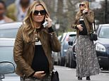 05.APRIL.2015 - LONDON - UK\n*** EXCLUSIVE ALL ROUND PICTURES ***\nABBEY AND PETER CROUCH SPENT A FAMILY DAY TOGETHER AT HAMPSTEAD HEATH FAIR. THEY WERE SEEN LEAVING THE FAIR AND HAD CLEARLY ENJOYED THEMSELVES. DESPITE BEING HEAVILY PREGNANT, ABBEY LOOKED GLAMOROUS IN LONG SKIRT AND HIGH HEELS. SHE WAS SEEN PLACING A PROTECTIVE HAND ON HER BUMP AND GIVING IT A RUB\nBYLINE MUST READ : XPOSUREPHOTOS.COM\n***UK CLIENTS - PICTURES CONTAINING CHILDREN PLEASE PIXELATE FACE PRIOR TO PUBLICATION ***\n**UK CLIENTS MUST CALL PRIOR TO TV OR ONLINE USAGE PLEASE TELEPHONE 0208 344 2007**