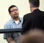 Carlos Colina, left, speaks with his attorney John Cunha, Jr., right, during his arraignment in Cambridge District Court in Medford, Mass., Monday, April 6, 2015.  Colina was charged with being an accessory after the crime of assault and battery causing serious bodily injury and the improper disposal of human remains, after the discovery of human remains in Cambridge on Saturday. (AP Photo/The Boston Herald, Chitose Suzuki, Pool)