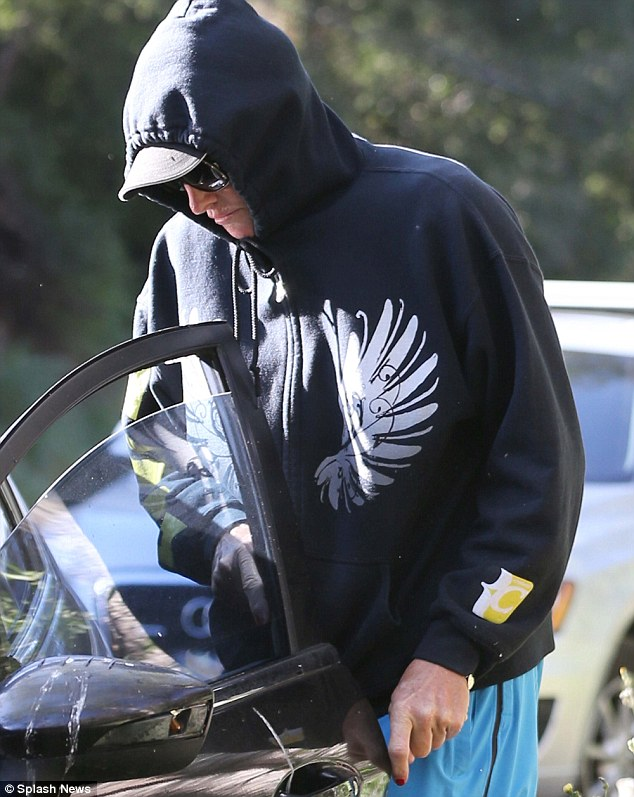 Hiding: He also apparently had painted his nails red when he was seen walking on Sunday