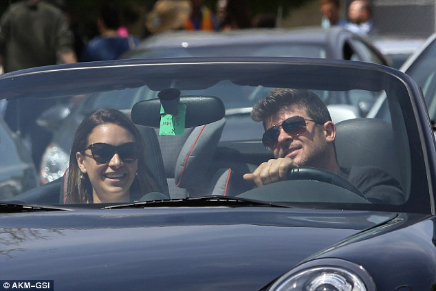 Bouncing back: Roin Thicke was seen enjoying a casual day out in LA with his girlfriend, April Love Geary, and his toddler son Julian, on Easter Sunday