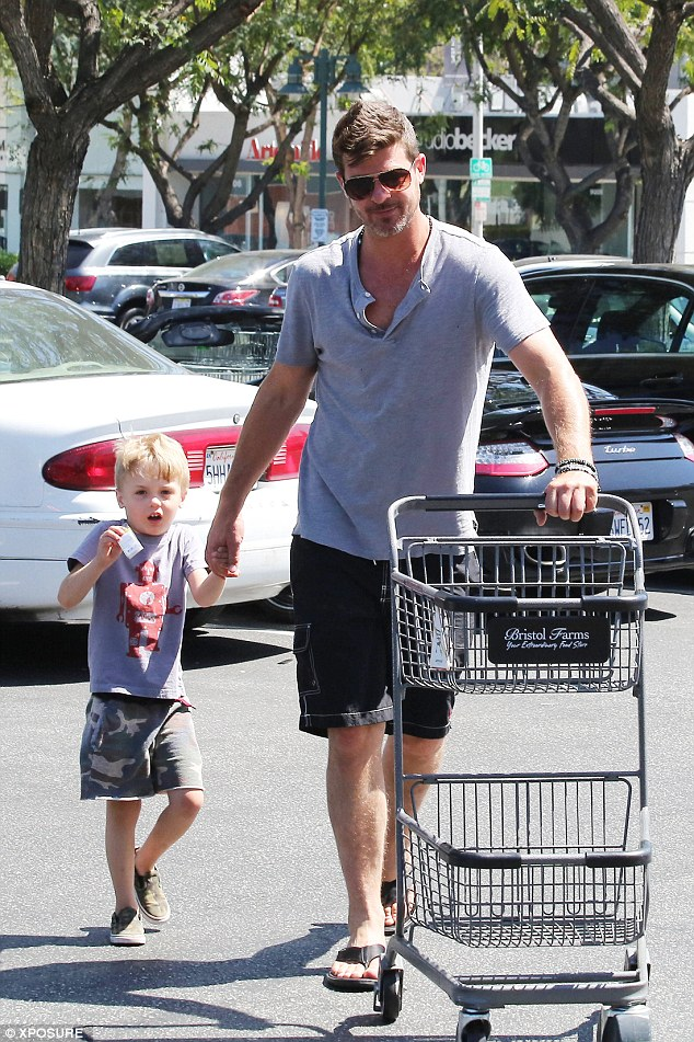 Paternal: Pictured with his 4 year-old Julian, the singer effortlessly showed his family-man credentials