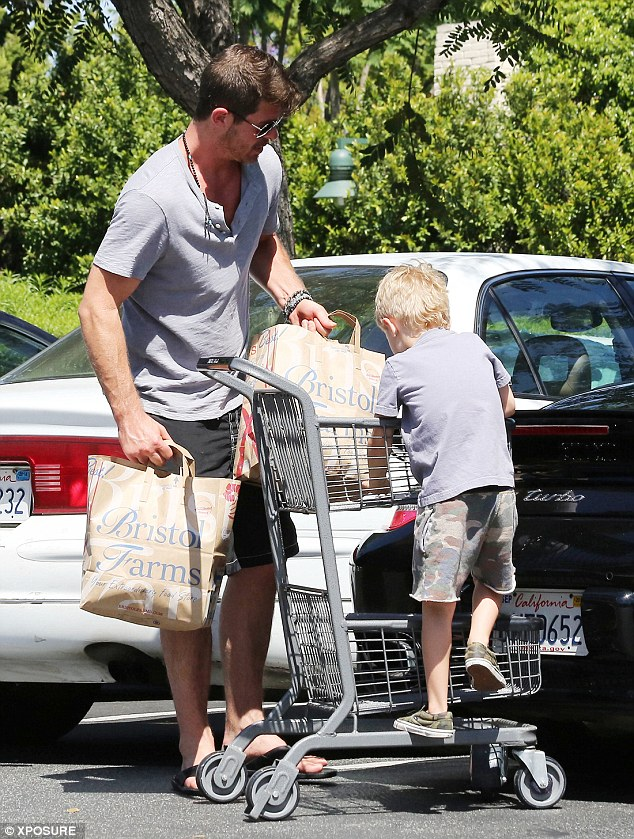 Playing: Humouring him, Robin steered the youngster along the parking lot before unpacking their purchases