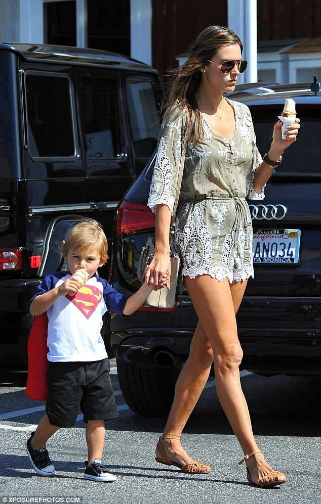 Tucking in: Alessandra Ambrosio went hand-in-hand with her two-year-old son Noah on Sunday as they enjoyed an ice-cream treat