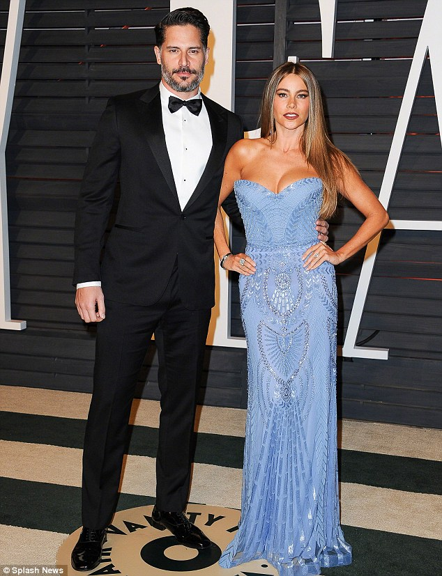 Handsome couple: The Hollywood couple are shown in February at an Oscars party in Beverly Hills