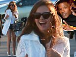Exclusive... 51702130 Celebrities spotted at Robert Downey Jr.'s 50th birthday bash at Barker Hangar in Santa Monica, California on April 4, 2015. Robert was seen carrying a lunch box, which all of the guests got a lunch box filled with gifts.. Jennifer Aniston channeled her inner Janis Joplin and Orlando Bloom planted a huge kiss on Justin Theroux's cheek. Gwyneth Paltrow arrived with her rumored new man, 'Glee' producer Brad Falchuk. Brad made sure to put his arm around Gwyneth as they walked into the party. Celebrities spotted at Robert Downey Jr.'s 50th birthday bash at Barker Hangar in Santa Monica, California on April 4, 2015. Robert was seen carrying a lunch box, which all of the guests got a lunch box filled with gifts.. Jennifer Aniston channeled her inner Janis Joplin and Orlando Bloom planted a huge kiss on Justin Theroux's cheek. Gwyneth Paltrow arrived with her rumored new man, 'Glee' producer Brad Falchuk. Brad made sure to put his arm around Gwyneth as they walked into