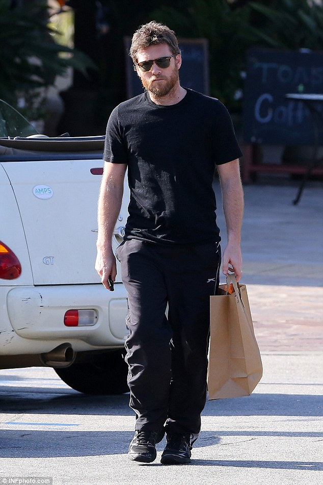 Feeding the family! Sam Worthington headed out to pick up some food in Los Angeles on Sunday, two weeks after his wife Lara Bingle gave birth to the couple's first child, son Rocket Zot