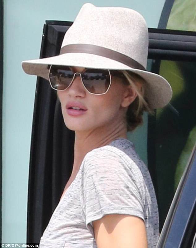 Fresh: Rosie Huntington-Whiteley looked fresh-faced on Sunday despite a late night with Orlando Bloom in West Hollywood