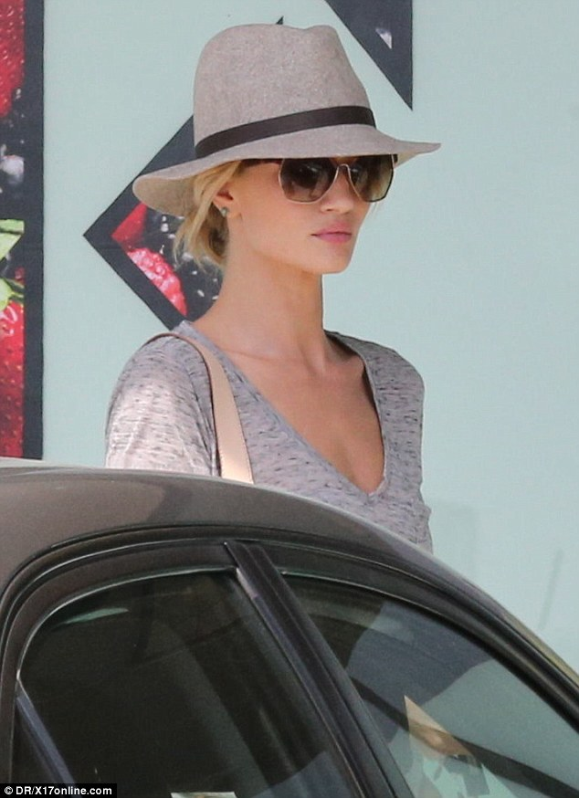 Elegant: The 27-year-old kept it simple in a V-neck grey t-shirt and minimal make-up