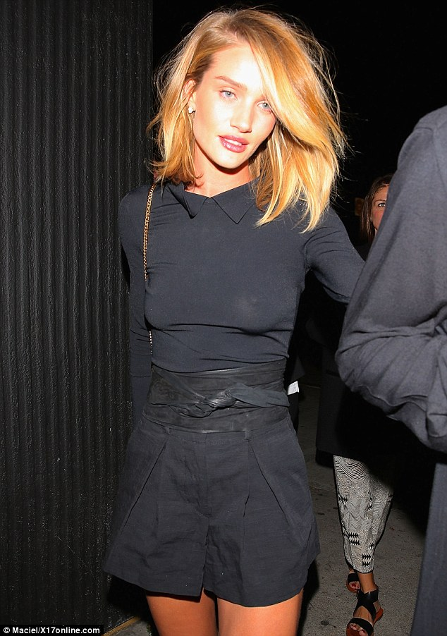 Stunning: Rosie's revealing outfit on Friday night drew admiring glances from fellow club-goers