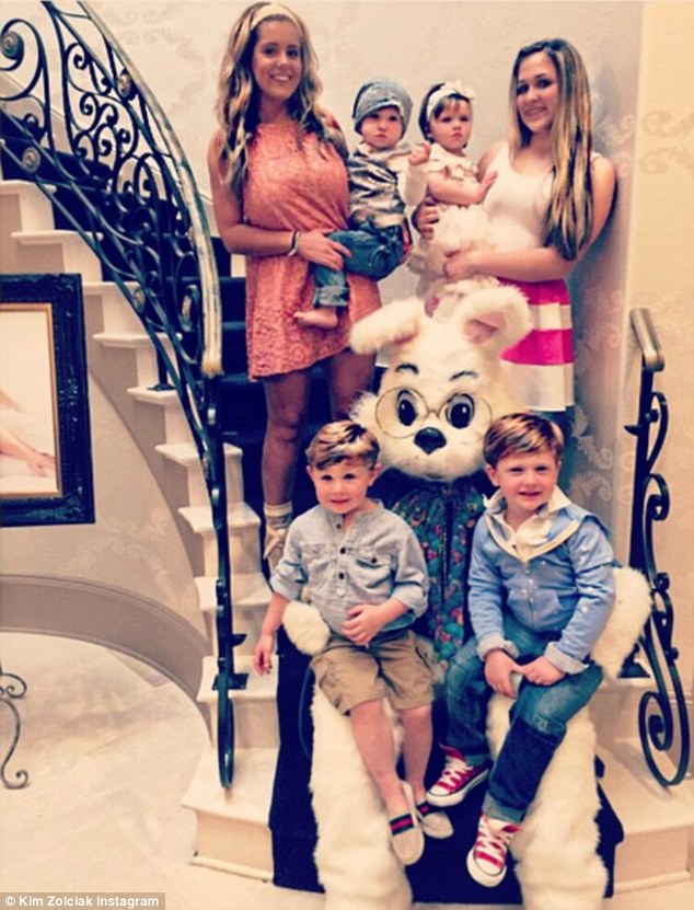 Family portrait: Kim Zolciak shared a snap of her six children on a staircase with the Easter Bunny