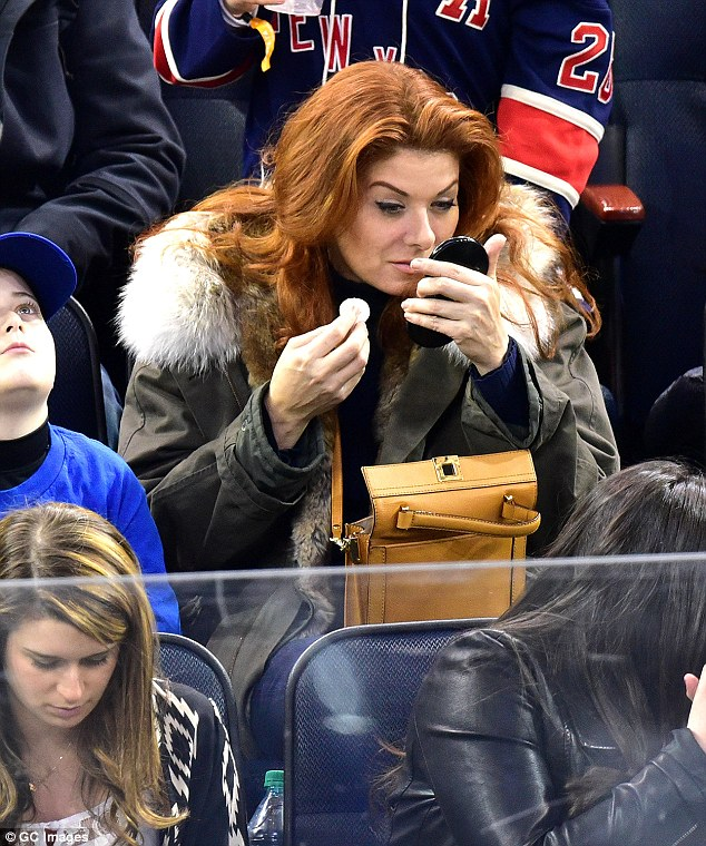 Ready for her close up? Debra Messing checked her makeup and powdered her nose while watching the NY Rangers play the NY Devils at Madison Square Garden on Saturday night